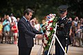 Saenuri Party Chairman Kim Moo Sung lays a wreath at the Tomb of the Unknown Soldier at Arlington National Cemetery (19842139338).jpg