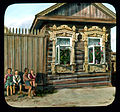 Saint Petersburg children in front of a house with elaborately-carved window frames, near Leningrad.jpg