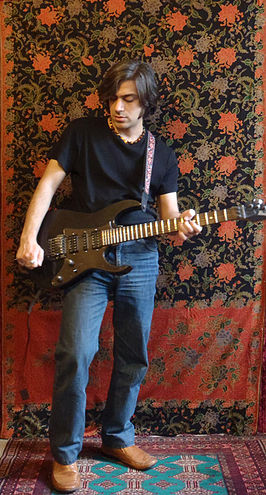 Salim Ghazi Saeedi playing guitar.jpg