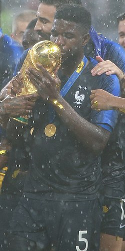 Samuel Umtiti World Cup Trophy.jpg