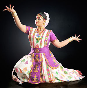 Sattriya - Sattriya dancer Krishnakshi Kashyap in a traditional Sattriya dance costume made of Assam Pat silk and traditional Assamese jewellery: Kopali on the forehead, Muthi Kharu (bracelets), Thuka Suna (earrings) and Galpata, Dhulbiri, Jethipata and Bena (necklaces). Traditional Kingkhap motif is used in the main costume with Kesh pattern on the border. The Kanchi or the waist cloth has the traditional Miri motif.