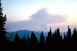 Smoke from a forest fire over the Sawtooth Wil...
