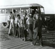 Children boarding a school bus in 1940.