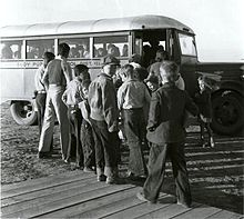 Children boarding a school bus in 1940.