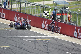 2013 British Grand Prix - Sebastian Vettel walks away from his car, having suffered a gearbox failure while leading with 19 laps to go.