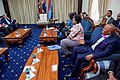 Secretary Kerry Jokes With a Staffer About His Bright Bow Tie in Nairobi (28865645160).jpg