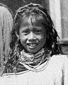 Seminole girl (center) face detail, Ruby Jumper Billie holding her infant Billie L. Cypress (2987122030) (cropped).jpg
