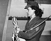 Sergeant Lena Mae Basilone christens USS Basilone (DD-824) at the Consolidated Steel Corporation Orange, Texas (USA), on 21 December 1945 (NH 103377)