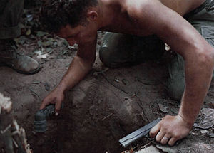 "Tunnel rat - A squad leader from alpha company, 1st battalion, 5th Mechanized Infantry of the 25th Infantry Division, checks a tunnel entrance before entering it to search for Viet Cong and their equipment, during Operation ""Cedar Falls"" in the HoBo woods, 25 miles North of Saigon on 24 January 1967."