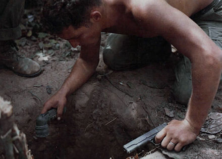 "A US ""tunnel rat"" soldier prepares to enter a Viet Cong tunnel. Sgt. Ronald H. Payne Tunnel Rat Vietnam War 1967.jpg"