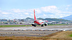 Shanghai Airlines Boeing 737-89P B-1512 Taking off from Taipei Songshan Airport 20151003.jpg