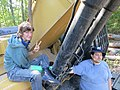 Shannon and Benjamin with arms locked over Keystone XL construction equipment.jpg