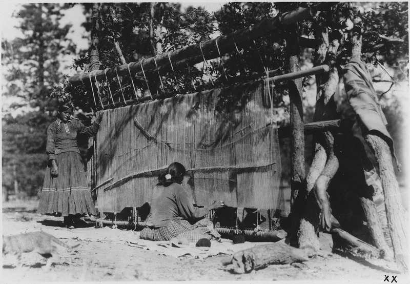 File:Showing Navajo women weaving one of the very large rugs for which Southern Navajo (Ganado district) Indians are... - NARA - 298594.tif