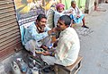 Sidewalk Barber (14842090604).jpg