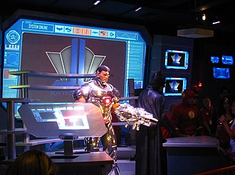 Justice League: Battle for Metropolis - Cyborg greets guests in his lab before they board their vehicles at all locations