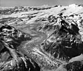 Snowy Mountain and Kukak Glacier, Mount Katmai and Knife Peak Crater in the background, and terminus of an ash covered mountain (GLACIERS 7045).jpg