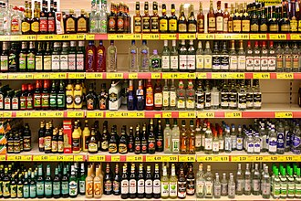 Liquor - A display of various liquors in a supermarket