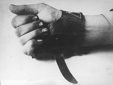 "The Srbosjek (""Serb cutter""), an agricultural knife worn over the hand that was used by the Ustase for the quick slaughter of inmates. Srbosjek (knife) used in Croatia - 1941-1945.jpg"