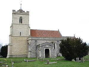 A stone church seen from the south with a red tiled roof showing, from the left, a relatively large embattled tower, then the south aisle with a porch