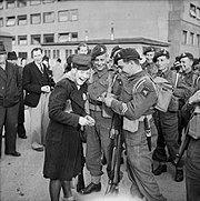Men of the 2nd battalion, South Staffordshire Regiment being greeted by Norwegian civilians on the arrival in Oslo of the 1st Airlanding Brigade