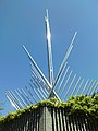 Stainless Steel Scultpure in Five Ways Island - blue sky.JPG