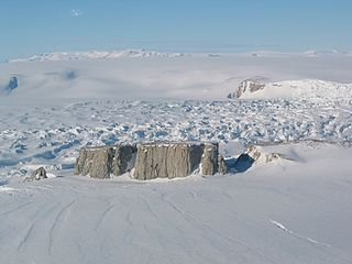 Nunatak Exposed, often rocky element of a ridge, mountain, or peak not covered with ice or snow within an ice field or glacier