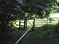Stile with mysterious pipe - geograph.org.uk - 517516.jpg