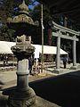 Stone Lantern and Torii in front of Haiden of Kashima Shrine.jpg