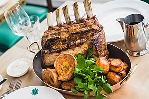 Sunday roast - Another Sunday roast with roast beef ribs, roast potatoes, various vegetables and Yorkshire pudding.