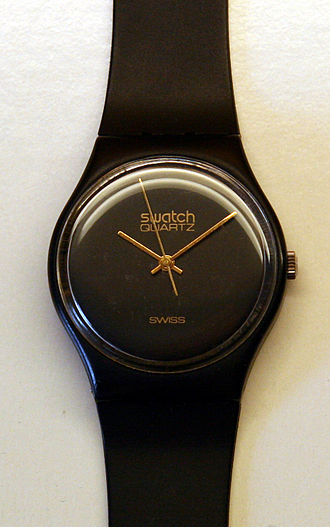 "Swiss made - A Swatch watch labeled ""SWISS"" to indicate  it is made in Switzerland"