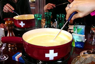 Fondue dish of melted cheese