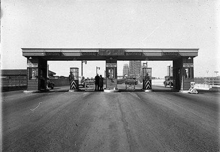 Sydney Harbour Bridge toll gates, photograph by Hall and Co., 1933, State Library of New South Wales Sydney Harbour Bridge toll gates, 1933.jpg