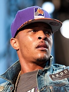 T.I. performing in concert, wearing a Phoenix Suns cap (cropped).jpg