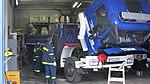 THW LKW Kipper Reserverad und gekipptes Fahrerhaus.jpg