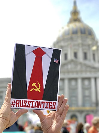Anti-Trump poster in San Francisco, presumably associating Trump with Russia or its former status as a part of the Soviet Union, April 15, 2017. Tax March SF (34074705055).jpg