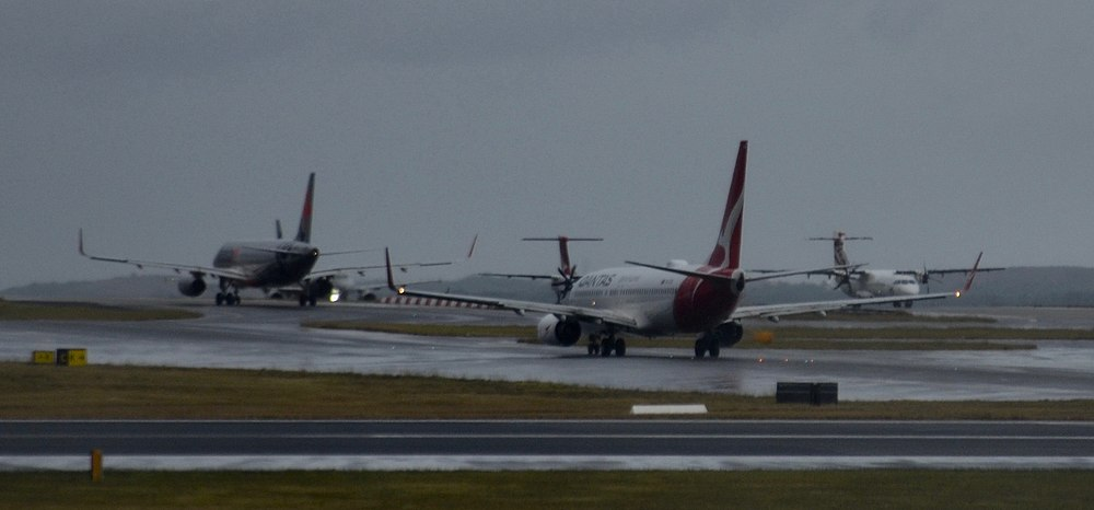 Taxiiing planes at Sydney Airport.jpg