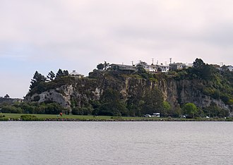 Musselburgh, New Zealand - The rocky outcrop of the Musselburgh Rise, seen from the eastern edge of Anderson's Bay Inlet.