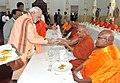 The Prime Minister, Shri Narendra Modi performed Dana (offering of alms) followed by prayer at the Mahabodhi Society, in Colombo, Sri Lanka on March 13, 2015.jpg