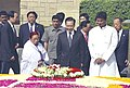 The Prime Minister of China, Mr. Wen Jiabao paying floral tributes to Mahatma Gandhi at his Samadhi at Rajghat in Delhi on April 11, 2005.jpg