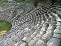 The cavea of the Roman theatre which included 21 rows of seats and had 6 radial stairway, Phaselis, Lycia, Turkey (9646234048).jpg