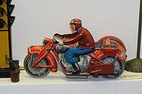 Tin toy motorcyclist (25538986695).jpg
