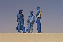 Group of Tuareg people in desert