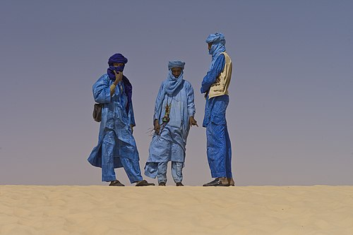 Tuaregs at the January 2012 Festival au Desert in Timbuktu, just before the MNLA launched the Azawadi rebellion later in the same month Touaregs at the Festival au Desert near Timbuktu, Mali 2012.jpg
