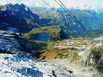 Wolfenschiessen - Looking down from the summit of Mount Titlis over the Trüebsee into the valley of the Engelberger Aa. Wolfenschiessen village is in the deepest part of the valley, in the top right corner of the image.