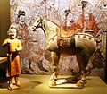 Tri-coloured pottery horse and groom. Tang dynasty.jpg