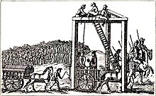 A monochrome illustration of a three-legged structure, with beams connecting each leg along the top (forming an equilateral triangle, on its side).  Several men are sitting at the top of the structure, near a ladder, about 20 feet above the people below.  A rope connects the top of the structure to the neck of a man, stood on a horsecart.  Another man is reading from a book, in his direction.  Horses pull another cart, on which two coffins can be seen.  A large crowd is gathered on the horizon, watching the scene.