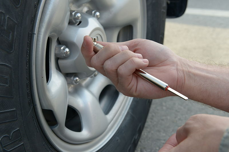 File:U.S. Air Force Staff Sgt. Dustin Roberts, a 379th Air Expeditionary Wing Public Affairs broadcaster, checks his tires at Al Udeid Air Base, Qatar, Jan. 10, 2014 140110-Z-QD538-010.jpg