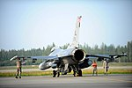 U.S. Airmen inspect an F-16 Fighting Falcon aircraft assigned to the 100th Fighter Squadron during Red Flag-Alaska 13-3 at Eielson Air Force Base, Alaska, Aug. 13, 2013 130813-F-UP786-009.jpg