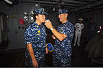 U.S. Navy Command Master Chief Shay Langejans, left, undergoes a blood alcohol level test on the officer quarterdeck aboard the aircraft carrier USS Dwight D. Eisenhower (CVN 69) Aug. 20, 2013, at Naval Station 130820-N-FK070-009.jpg
