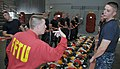 U.S. Navy Quartermaster 2nd Class Michael Wignall, a facilitator in the USS Chief (MCM 14) Fire Fighting trainer at Recruit Training Command, instructs recruits with Division 816 how to line up as a hose team in 120702-N-IK959-848.jpg